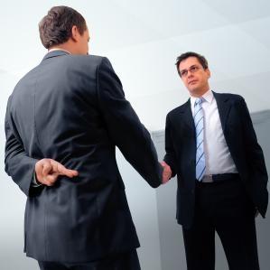 handshake with fingers crossed behind back