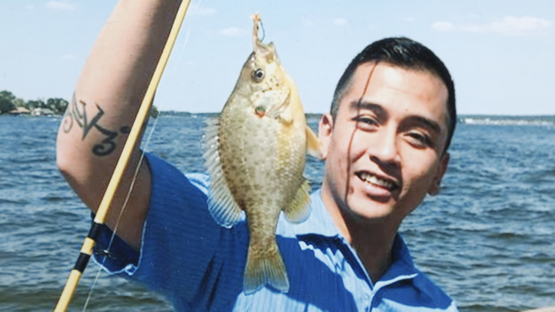 Angelo Quinto Holding a Fish