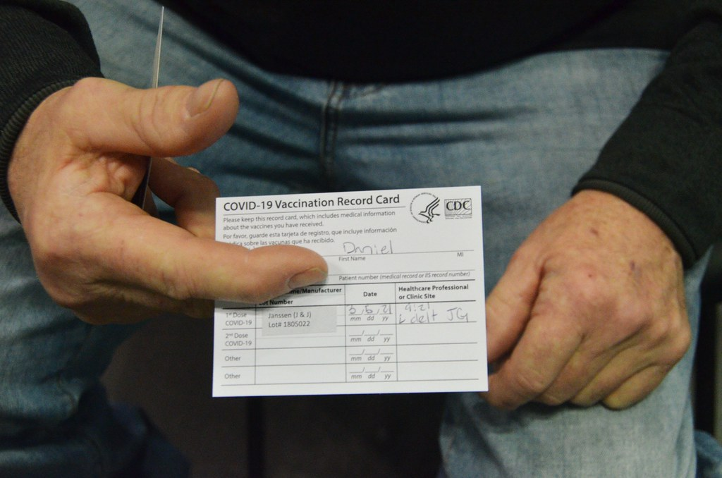 Person Holding a Vaccine Card
